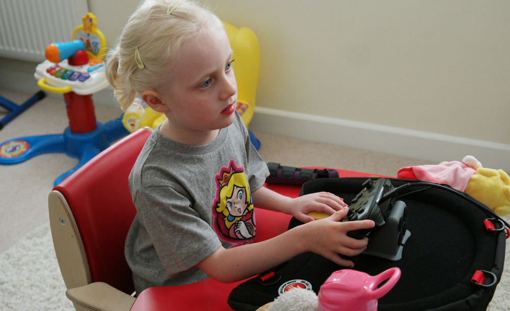 Seated girl playing games