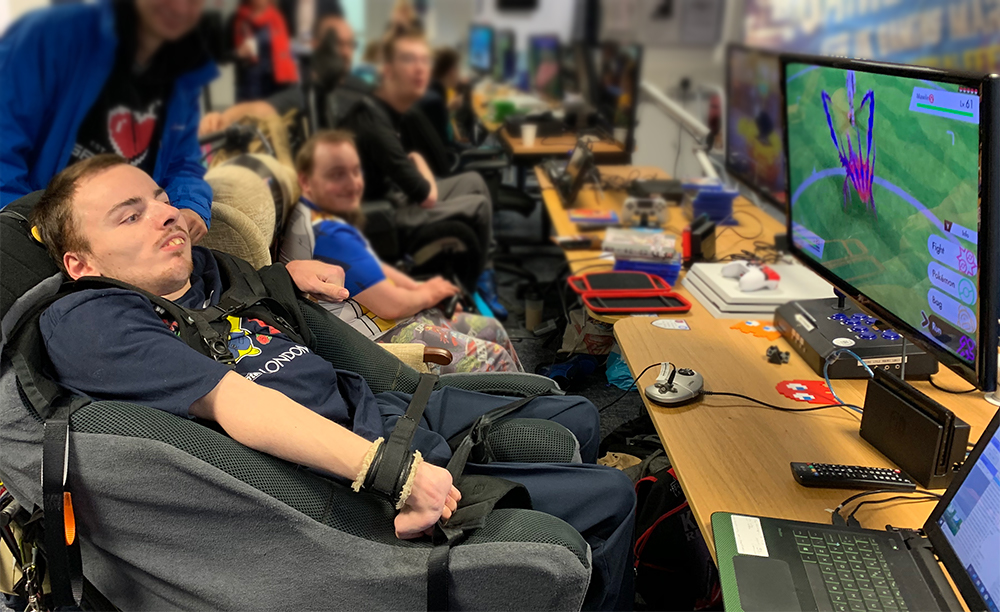 Man in wheelchair playing games