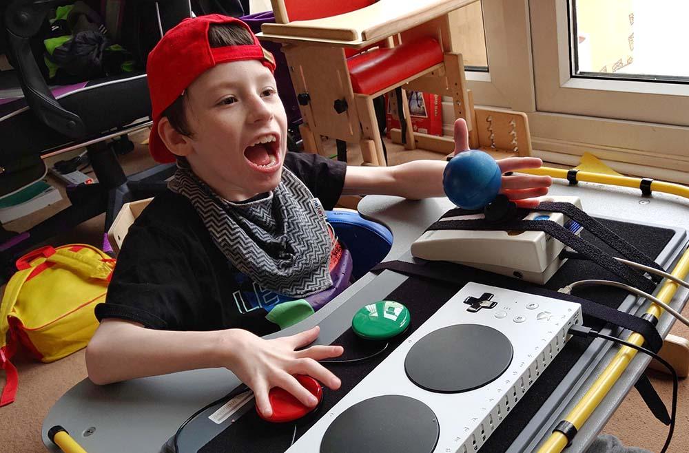 Smiling boy playing video games