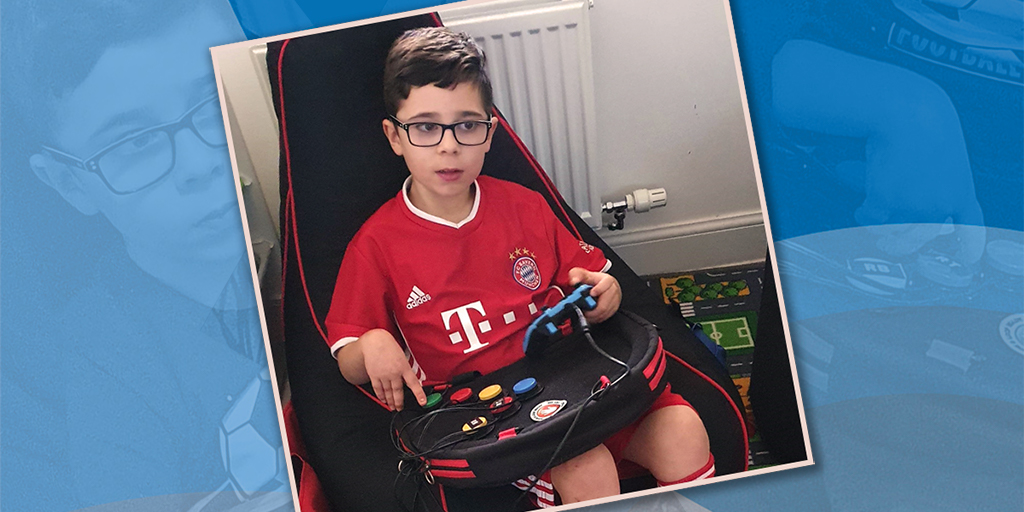 Seated boy playing video games