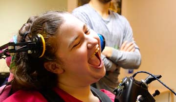 Laughing girl in wheelchair